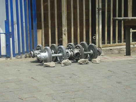 recycled car gear dumbells