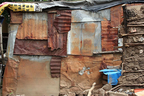 recycled metal in African shack home