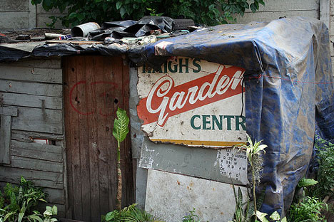 recycled signage and wood in an informal settlement